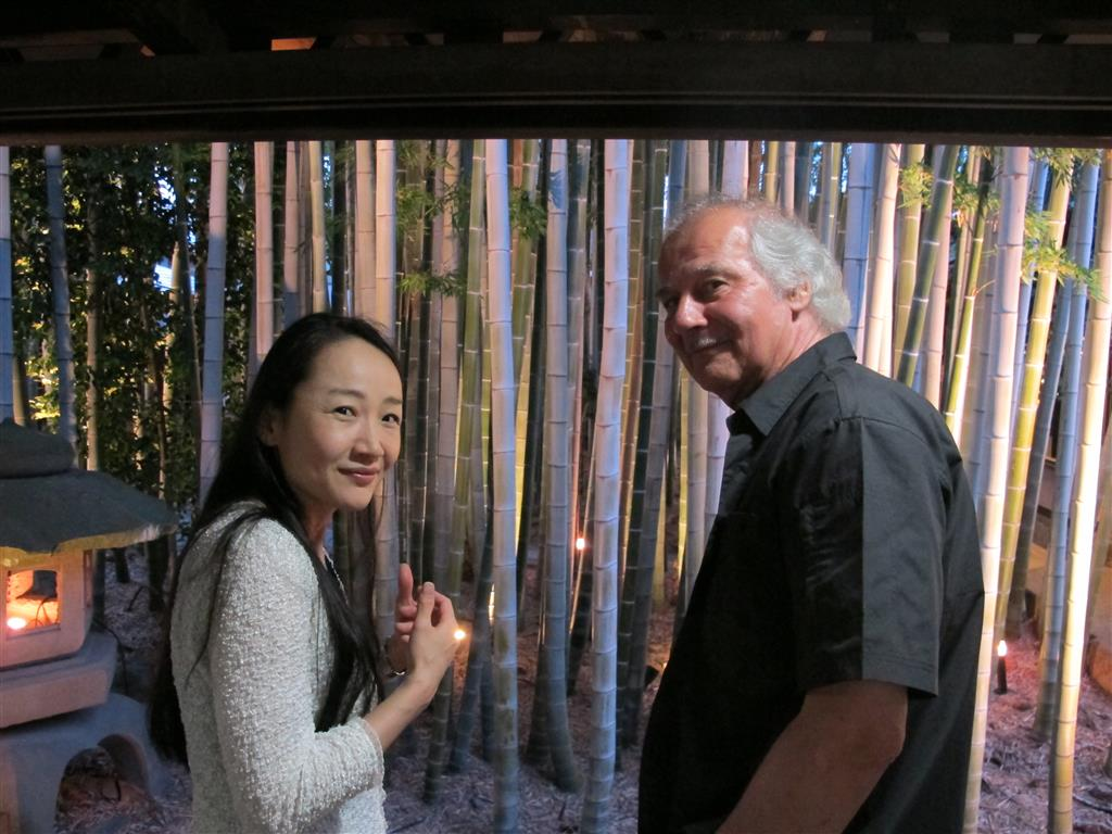 Two of our speakers, Akiko Morita and Hugo Kempeneer chatting by the interior garden.