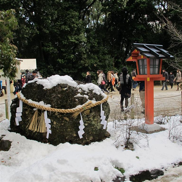 The shimenawa ropes that decorate this rock siginify that it is venerated as the dwelling place of kami - the Shinto gods.