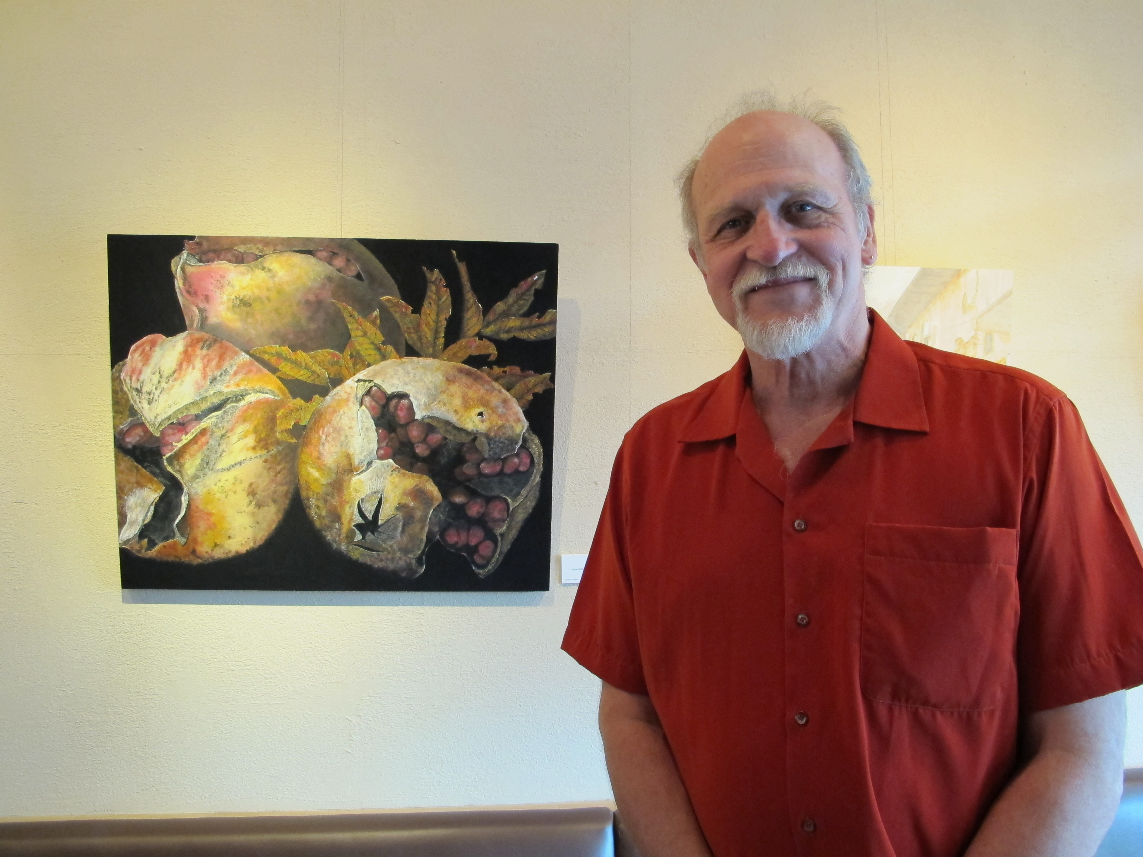 "Charles with one of his most recent pieces, ""Inexorable Autumn""."